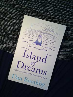 The island of Dreams book set against a blue sealike background