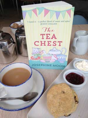 The Tea Chest novel with tea and scones